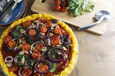 Lighten the load with this flourless vegan polenta pizza recipe, topped with roasted vegetables.