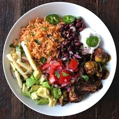 It's a fun fiesta Meatless Monday! Mexican rice, simmered black beans, tangy orange jicama slaw, tomato salsa, avocado, pineapple-glazed Brussel sprouts, a dollop of Tofutti Brand sour cream & jalapeños. So yummy, and the best part is it was assembled using all the veggies we prepped yesterday!
