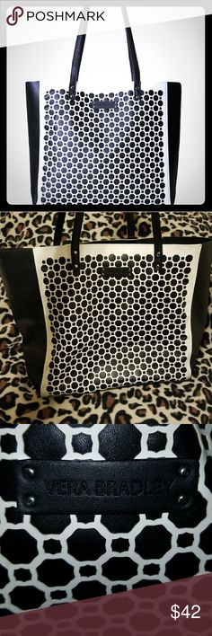 VERA BRADLEY Laser Cut Geo Shaped Black/White Tote So chic!!! This laser cut gorgeous Vera Bradley geo design tote purse is crafted in supple faux leather. Inside, you'll find one multi-function hanging slip pocket which keeps smaller items organized.Height 17 1/2, Width 12 1/4, Depth 6 1/2. Offers welcome! Vera Bradley Bags Totes