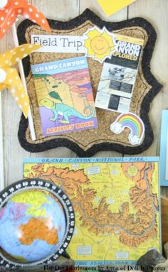 Doll size maps, brochures and books to help plan their upcoming trip!