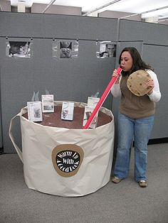 Warm up With a Good Book! Display in library. small round table wrapped to look like hot cocoa. Books are the marshmallows.