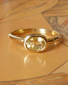 Oval Cut Maize Yellow Sapphire Ring by kateszabone on Etsy. $565.00, via Etsy.