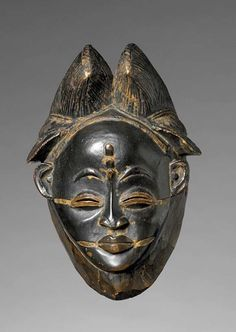 Africa | A face mask from the Punu people of Gabon | ca. 19th century | Wood and pigments.