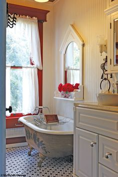 Farmhouse Fresh Bathroom: Antique claw-foot tub, estate sale mirror, Pullman cabinet, marble countertop, marble backsplash, beadboard cabinet.