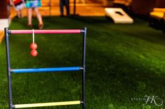 """For a fun spin on traditional events at The Ritz-Carlton, Denver, create a """"lawn game"""" activity area where guests can interact with each other while playing classic outdoor games like ladder and bean bag tosses. Be sure to add turf for an outdoor feel in the indoors."""