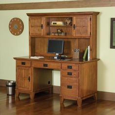 Home Styles Arts and Crafts Desk and Hutch combo features a solid hardwood construction in a rich cottage oak finish. Desk features four easy glide drawers, center drawer drops down to accommodate a keyboard tray, side compartment on left holds CPU,