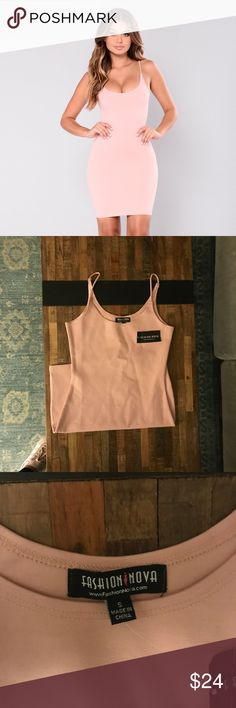 Fashion Nova Light Pink Bodycon Dress Bodycon mini dress w spaghetti straps.  Light Pink.  Size small.  95% Polyester 5% Spandex.  Never Worn.  The material is thick & not see through.  Very flattering tight Fit however this dress runs small for Fashion Nova in my opinion. Fashion Nova Dresses