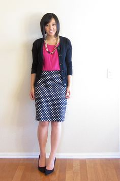 Navy cardigan, bright pink knit top, navy w/ white polka dots skirt, black heels, gold chain necklace