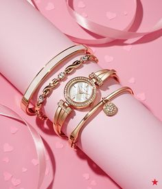 A box of chocolates and glistening arm candy? Now, that's what you call a sweet Valentine's Day gift! —Anne Klein crystal accent rose gold-tone watch & bracelets set