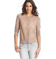 Lace Front Cardigan - Casually lacy – and oh so lovely – this darling cardi shows off irresistibly girly attitude. Add a cami beneath for more coverage. Crew neck. Long sleeves. Button front. Ribbed neckline, cuffs and hem.