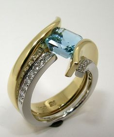 Hand Made and Hammer Forged 18k gold split sea wave with tension set Brazilian Aquamarine Engagement Ring on Etsy, $17,883.11