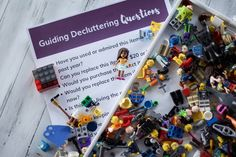 Guided decluttering questions cheat sheet with lego people laying over #organized #declutter