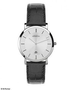 Le magazine ELLE choisit la montre Epsilon de la maison Michel Herbelin pour sa rubrique Mode Homme.