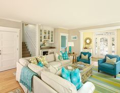 Karen here is turquoise, yellow and light brown. Beach Style Family Room by Renaissance South Construction Co.