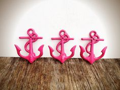 Here is a set of three traditional nautical themed cast iron Anchor wall hooks. They have been hand painted a vibrant hot pink, lightly distressed, and