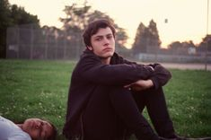 """Petra Collins: """"My sister's boyfriend Fox on his last day of high school. The sun was setting, and he and his friends were all playing around. I caught him in a moment of reflection."""""""