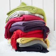 Available in vibrant solids, dip-dyed ombre, or contrasting stripes, our Softest Throws are a perfect warming layer for a sofa or bed.