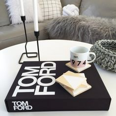 Typography is the go to for a statement in any room. This Tom Ford book is a great way of doing just that. Also lusting over the blonde wooden coasters