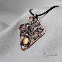Hammered wire wrap copper pendant with shell and beads by Artual