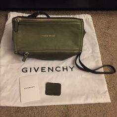"Givenchy Mini Pandora Tricolor,Olive/Dk Olive, BLK 100 % Authentic Givenchy mini Pandora Crossbody.  - Color: Olive/Dk Olive/ Black.  - Metal logo lettering and zip pocket at front, polished silvertone hardware - Lined with black canvas; leather-trimmed zip pocket at interior - Adjustable flat leather crossbody strap Top zip closure - Dimension: 5.5"" height x 9.5"" width x 4.5"" depth, approximately - 23"" maximum strap drop, approximately - Made in Italy - Brand New, never worn - Dust bag…"