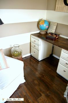 Polurethane faux wood plank floor (strips of brown craft paper), Freckle Face Girl for Remodelaholic. Tutorial. Also the Wood topper on cabinets is a nice desk look. Lots of pics on site.