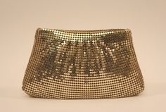 Make your evening wear more stunning with this Whiting & Davis Gold Mesh evening bag.  (www.handbagconsignmentshop.com)