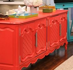 Refurbish an inexpensive thrift store find into a kitschy statement piece.  Go bold with color.  Krylon Spray Paint has an awesome palette of new colors.  Dress it up with some new hardware.