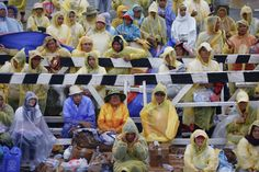 Pilgrims protect themselves from the rain and wind as they listen to Pope Francis during a mass at Tacloban's airport January 17, 2015. An emotional Pope Francis, wearing a plastic poncho over his vestments to protect him from the wind and rain on Saturday, comforted survivors of Typhoon Haiyan, the Philippines' worst natural disaster that killed about 6,300 people 14 months ago. REUTERS/Damir Sagolj (PHILIPPINES - Tags: RELIGION ENVIRONMENT) less Wind And Rain, Pilgrims, Pope Francis, Natural Disasters, Philippines, Religion, January, Environment, Plastic