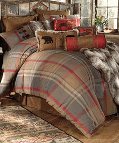 Mountain Trail Rustic Bedding  Create a woodsy feel in your bedroom with the woven cotton plaid Mountain Trail Rustic Bedding Set in red, dark gold and gray accented with chestnut and red microsuede and antler loop buttons. The Mountain Trail Plaid Bedding Collection is available in Queen and King size.  Mountain Trail Bedding Queen Size Set Includes: Bed