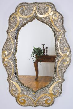 Pearl Mirror 35h x 23w x 2.5d Sculpted mirror frame. Umbonium shells, glass beads, vintage rhinestones, metal gold leaf & freshwater pearls Private Collection//Minnesota, USA