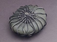 Steel Wrapped Rock by MaryTucker, via Flickr