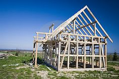 A new wooden house being constructed, the frame  looks contrasty on saturated blue sky background.  <a href='http://www.dreamstime.com/interiors-rcollection5192-resi208938' STYLE='font-size:13px; text-decoration: blink; color:#FF0000'><b>HOME BUILDING & RENOVATION »</b></a>