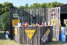 Outdoor bar built with old fencing wood ( shared by WedPics.com )
