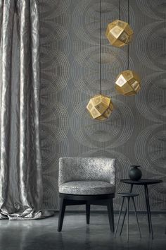 Dark grey patterned circles on this modern and stylish wallpaper create a stunning wall.