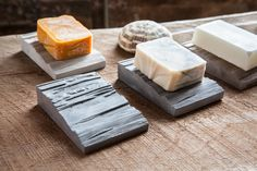 SLOPE is a concrete soap holder designed to help prolong your soap by keeping it dry. It does this with a built in drainage system designed to allow