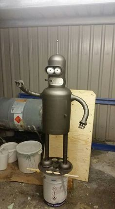 Custom geeky chimineas , wood burners and BBQs by Ben Cox of BC Bespoked. This Bender Bending Rodriguez chiminea was fabricated from a bottle and a cylinder, you can also order Star Wars-… Metal Yard Art, Scrap Metal Art, Minion Fire Pit, Gas Bottle Wood Burner, Wood Stove Heater, Futurama Bender, Fire Pit Grill, Metal Fire Pit, Chiminea