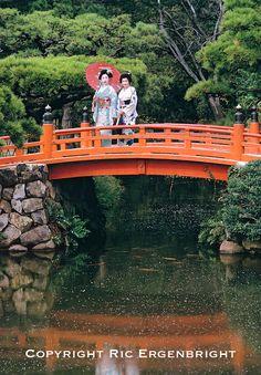 Models in formal kimono pose on a bridge in Ritsurin Park in Takamatsu, Shikoku, Japan. ©Ric Ergenbright