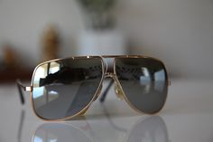 Gold Aviator frame with Mirror Polarizing Lenses from Polaroid's Vintage Sunglasses Collection.     Product ID POLAROID LOOKERS 4558 with Polarizing Lenses  $35