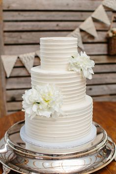 white buttercream peony cake