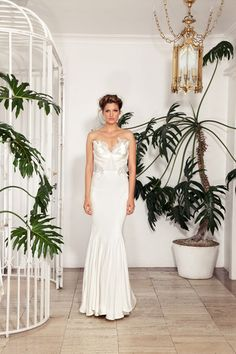 wedding dress by Rachel Gilbert | via junebugweddings.com