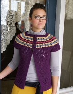 I really like this little sweater!  You have to look around this webpage though to find the free pattern.  It's there!