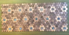 penny or nickel tile interlocking sheets for easier coin tile installation than hand-setting individual pennies and nickels. Penny Tile, Coin Art, Copper Penny, Mint Coins, Tile Installation, Pennies, Outdoor Projects, Deco, Projects To Try