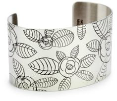 "Tattooed Steel ""Secret Garden"" Rosie Marie Stainless Steel Cuff Tattooed Steel. $50.00. If laid out flat, the cuff measures 5.5"" by 1.5"". Our Rosie Marie stainless steel cuff features a whimsical floral design, and is one of our ""Secret Garden"" collection cuffs.. Made with premium grade stainless steel, this item is very durable.  All of our products are made in our Huntington Beach, California facility using various metal etching techniques and coating processes tha..."