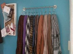 a towel bar with shower curtain hooks = scarf organizer. really need to do this! and use for bags also! by vonda