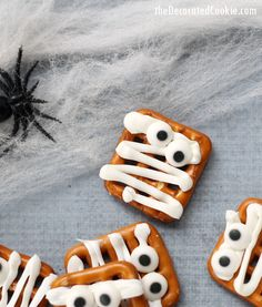 """These mummy pretzels fall into the category of """"quick and easy Halloween treats."""" They take minutes to make and you can find the few things you need at the craft store. Plus, messy makes for scarier mummies, so you don't need to pipe perfectly, which also makes these a good let-kids-make-themselves Halloween treat. (Not...Read More »"""