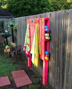 PALLET POOL HOLDER...what an awesome idea that is affordable to hang those towels and pool noddles :)   FOLLOW me! :) https://www.facebook.com/sonyaylangdon