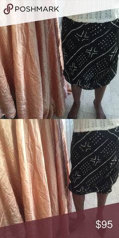 """Ralph Lauren skirt Ralph Lauren silk poplin skirt. African mud cloth print, Blk/beige,silk with silk lining. Elastic waist and elastic at the hem of skirt. Can be worn as a tunic top or dress depending on your size. Label says XL, runs small. May fit SM/Med/L. Wore once had to mend 1/4"""" at bottom of side seam not visible because side seam is black and just 1/4"""" Ralph Lauren Skirts Midi"""