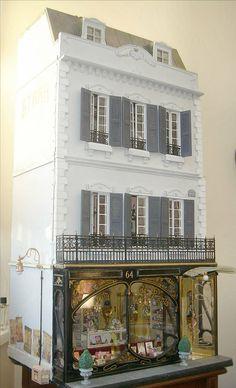Dollhouse with Art Nouveau shop front on bottom floor