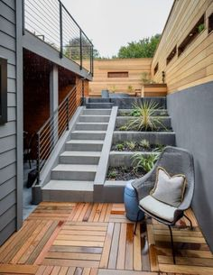 The terraced backyard includes a covered patio and drought-tolerant plantings. P … - Modern Home Interior Design, Exterior Design, Terraced Backyard, Garden Stairs, House Stairs, Small Terrace, Small Patio, Outdoor Stairs, Staircase Design