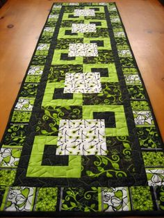 Black and Green Geometric Table Runner--this is on Etsy, so no pattern, but I love the colors.